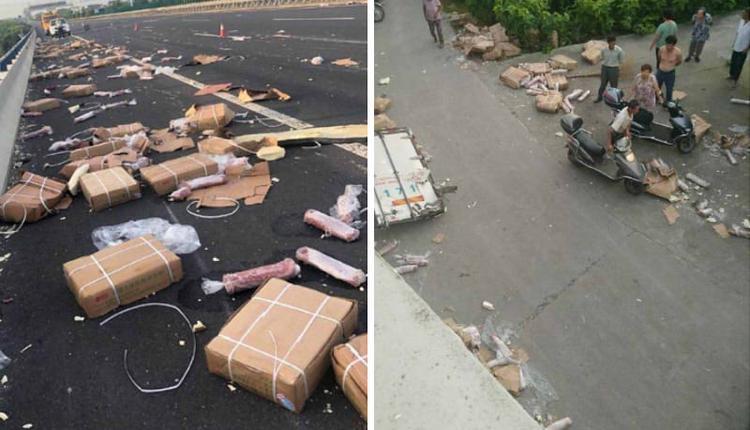 货车遇车祸猪肉散落遭哄抢