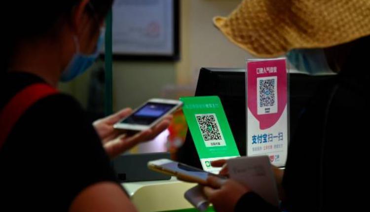 中國商店出現的支付寶與微信支付掃描板