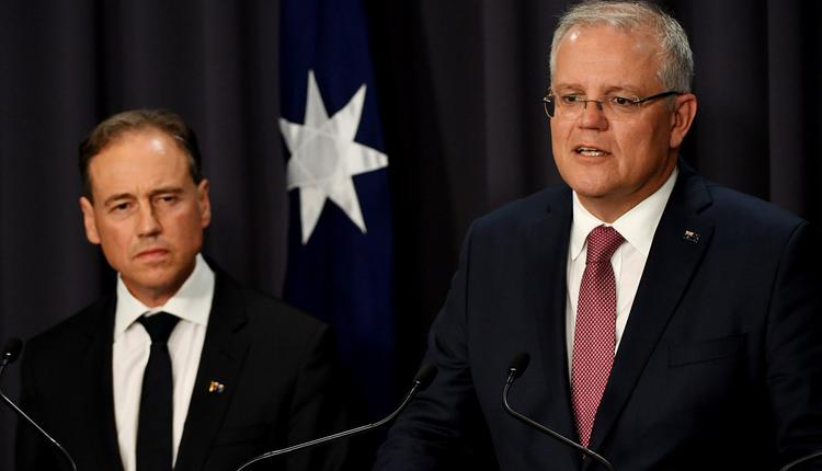 澳洲总理莫里森(右)和联邦卫生部长Greg Hunt(左)