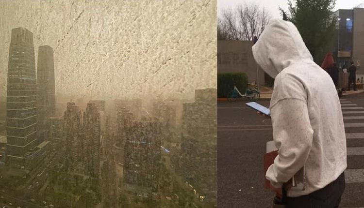 北京再遭沙尘暴袭击 泥雨让人遭殃