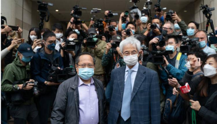 大律师李柱铭及民主党前主席何俊仁