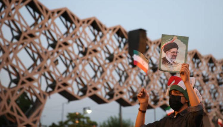支持者庆祝莱西当选伊朗总统