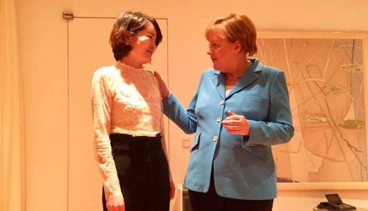 德国总理默克尔会见李文足。